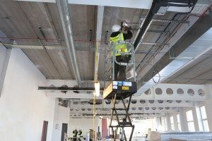 Jackson Fire engineer Scott Hughes working on the new detection and alarm system being installed at the new Moneypenny HQ, Wrexham